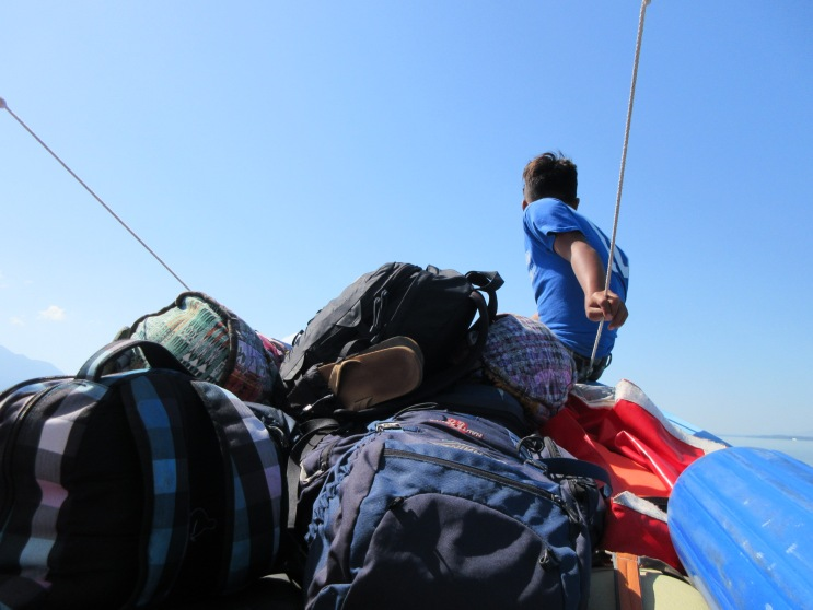 Luggage piled high in the bow of the boat,