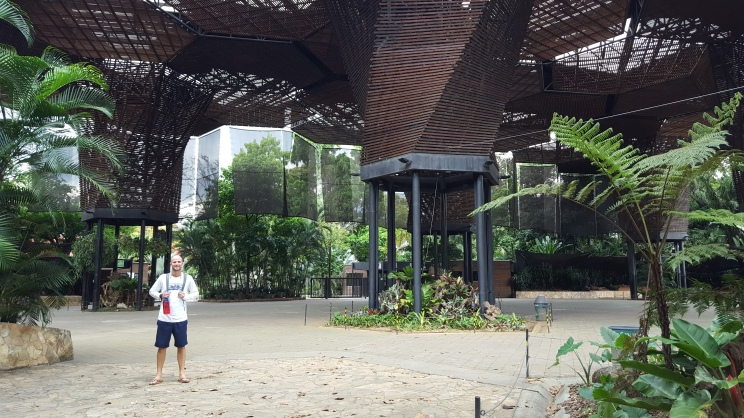 Jeff under a cool wooden structure in the botanic gardens